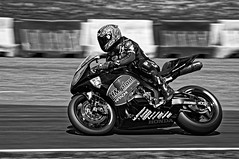 Falling........, with style (Neil B's) Tags: falling style mallorypark racing bikes speed panning bw noir blackwhite