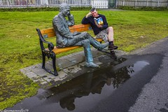 IMG_5984 Self Bench in Reykjavik - 01 (davemacnoodles59a) Tags: july2014 summertime raw tripod myweeicelandtripjuly2014 grass green puddle reflection water selfie selfieinreykjavikoniceland selfieiniceland selfportrait selfportraitinreykjavikoniceland selfportraitiniceland sculpture sculptureinreykjavikoniceland sculptureiniceland touristattraction visitiorattraction reykjavikinicelandattraction icelandattraction weewalks julywalks summerwalks reykjavikinicelandwalks icelandwalks citywalks canondslr canoneos550d adobephotoshopcs6 reykjavikiniceland iceland tintinselfreykjavikjuly2014