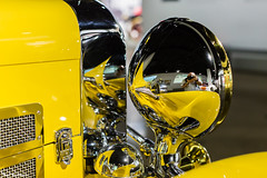 Selfie in headlight (Thad Zajdowicz) Tags: zajdowicz losangeles california petersenautomotivemuseum availablelight indoor inside museum canon eos 5dmarkiii 5d3 dslr digital lightroom ef50mmf12lusm 50mm primelens car automobile vehicle transportation selfie reflection headlight chrome detail color yellow shiny mirror bokeh depthoffield dof