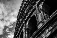 The colosseum (NikNak Allen) Tags: italy rome roman building architecture light shadows sky clouds old history tourism up arches black white grey blackandwhite