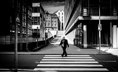 Man crosses the street B&W (matwolf) Tags: man mann crossing street streetphotography zebrastreifen cebracrossing town stadt bw blackandwhite black blanc blackwhite blancetnoir noiretblanc ngc noir noirblanc negro negroyblanco enblancoynegro blanco schwarz schwarzweis urban architecture strase