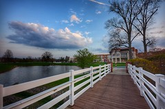Crossing the Bridge (mswan777) Tags: bridge pond walking pathway railing building architecture olmsted falls ohio travel sunset evening sky cloud nikon d5100 sigma 1020mm outdoor water landscape tree lawn fountain
