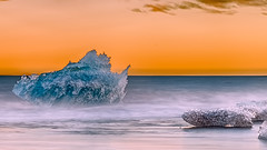 Diamond Beach (PokemonaDeChroma) Tags: jökulsárlón hss iceberg jokulsarlon diamondbeach iceland ice sunset cold warm fireandice long exposure motion orange turquoise 💛 austerskaftafellssysla