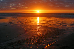 And finally, at the end of a grey day... (John Ibbotson (catching up!)) Tags: ocean sunset sea sky sun reflection beach wales clouds sand ceredigion borth
