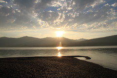 big sky sunset (bbosica20) Tags: blue sunset sun lake mountains beach yellow clouds montana rocks glacier bigsky glaciernp bigskycountry 2013