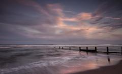 Pink on Blue (Elidor.) Tags: morning pink sky beach sunrise reflections dawn berwick groynes spittal d90 elidor northumbnerland