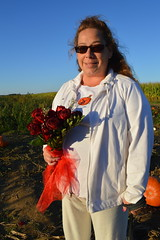 Renee Halliwell in the pumpkin patch with gothic red roses (RYANISLAND) Tags: thanksgiving family autumn orange holiday fall halloween garden season pumpkin fun outdoors october fallcolor farm fallcolors 14 pumpkins farming seasonal samhain celebration squash pumpkinpicking celtic calabaza autumnal 31st happyhalloween equinox calabasas calabash 2014 calabazas orangecolor happythanksgiving autumnalequinox colororange october31st orangecolors oícheshamhna calabasse colorsorange oíche 142014 samhainfestival celticholiday shamhna pickpumpkins thesamhainfestival