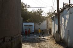 Uzbek street football (Andrew G Robertson) Tags: road street 3 eos football asia iii central silk streetphotography streetlife backstreet silkroad 5d uzbekistan centralasia bukhara ronaldo mk ozbekiston bokhara buxoro canon24105mm canon5dmkiii