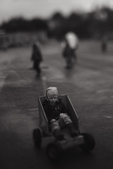 (Dalla*) Tags: boy portrait white black rain lensbaby children outside kid alone sad lonely toycar schoolfield wwwdallais edge80