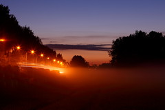 Untitled (Elektrojnis) Tags: sunset mist field fog haze sundown vivid eerie haystacks lighttrails colourful lightstreaks tractoreggs