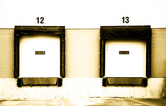 take a number (Maryann Clark) Tags: door two canada industry truck dock ship edmonton empty 14 warehouse number commercial alberta trailer shipping 13 load courier freight trucking thirteen fourteen receiving unloading receivingdock