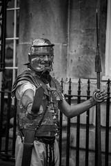 roman soldier (Daz Smith) Tags: city portrait people urban bw man streets canon soldier blackwhite bath roman candid citylife thecity streetphotography sword armour spear canon6d dazsmith bathstreetphotography