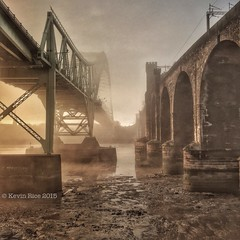 Misty mud (Grains of Rice) Tags: bridge mist fog sunrise silver river jubilee hdr mersey iphone runcorn rivermersey runcornbridge iphonography snapseed