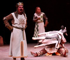 """(L to R) Gary Beach as King Arthur, John Scherer as Sir Robin and Andy Taylor as Patsy (under the cow) in the 2010 MC premiere of the Tony Award-winning Best Musical """"Monty Python's Spamalot"""" at the Wells Fargo Pavilion, July 9-18.  Photo by Charr Crail."""