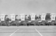 Summer is coming:  Lifeguard stations in a parking lot.  Ilford hp5 (C_Kho) Tags: baywatch lifeguards crystalcove bw film analog 35mm rangefinder lessonsinlightmetering