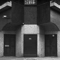 Fire Exit (ss9679) Tags: 500cm 6x6 fp4 hasselblad birmingham urban architecture abstract symmetrical 120 ilford pushedfilm 400 fp4at400 hc110 kodakhc110 fireexit sonnar 150mm zeiss square blackandwhite doors tiles mediumformat mittelformat telephoto cf analog film filmdev:recipe=11348 ilfordfp4125 film:brand=ilford film:name=ilfordfp4125 film:iso=400 developer:brand=kodak developer:name=kodakhc110