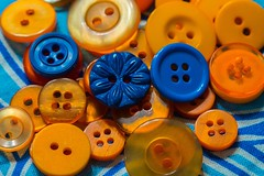 Orange and Blue--HMM! (amarilloladi) Tags: macromondays macro fabric buttons blue orange orangeandblue 7dwf