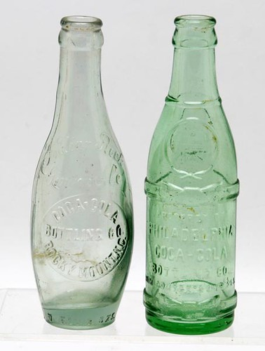 "Early Coca-Cola bottles including amber Norfolk, Virginia, aqua Rocky Mount, NC ($336.00) and Philadelphia ""Bow Tie"""