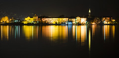 Strings of Light (Lolo_) Tags: longexposure poselongue lake reflection lac maggiore night reflet île island majeur stresa pescatori pêcheurs lago piémont piemonte italia italy lights lumières isola superiore verbania church clocher crane grue colored italie