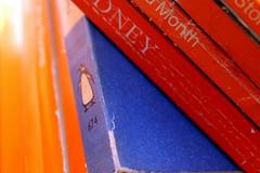Penguins (overthemoon) Tags: books penguin blue orange macromondays orangeandblue closeup macro spines biography