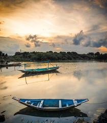 Sunset at Surabaya (jenvendes) Tags: surabaya indonesia travel beautiful nature sky east landscape java sun clear landmark sunset golden boat water reflection sea clouds