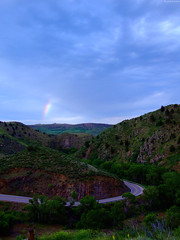 """Rainbow fragment in blue clouds above rocky hills • <a style=""""font-size:0.8em;"""" href=""""http://www.flickr.com/photos/34843984@N07/14924928693/"""" target=""""_blank"""">View on Flickr</a>"""