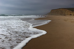 Cloudy Day in Monterey (takenbygabi) Tags: ocean california travel sea summer people cliff white beach clouds speed landscape grey coast monterey sand waves slow place pacific cloudy sandy gray wave foam edge shutter coastline