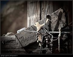 ROADSIDE MEMORIAL (george alexander garcia photography) Tags: wood family blue light broken death beads wire highway memorial colorado shrine sad cross arm spirit mary jesus mother memory crucifix rosary weathered spiritual sins beeds