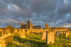 Whitby Abbey as seen from the graveyard at sunset (kevaruka) Tags: uk greatbritain family sunset sea summer england sky cloud sun holiday church graveyard sunshine clouds canon coast seaside flickr shadows cloudy unitedkingdom bokeh harbour dracula whitby legends 5d legend frontpage northyorkshire englishcountryside sunnyday whitbyabbey 1635 bramstoker canon24105l canon5dmk3 5dmk3 5d3 5diii thephotographyblog canoneos5dmk3 august2014