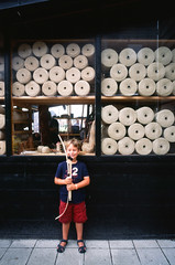 At the rope-maker's. (Lars Plougmann) Tags: boy film denmark rope lucas bowandarrow fujivelvia50 ropemaker vikingeskibsmuseet 14050036
