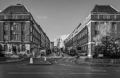 Bookends (jasonmgabriel) Tags: road city bw white black bus tree monochrome buildings leeds eastgate