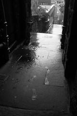 Leave nothing but footprints (Lucky Poet) Tags: wet rain scotland blackwhite edinburgh footprints oldtown advocatesclose