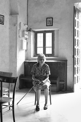 Lady In Church - Apricale - Italy (Pat Meagher) Tags: street travel photography candid liguria streetphotography documentary 7d apricale streetcandid originalphotography canon7d skancheli patmeagher paddym01 paddym01tumblrcom