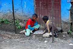 Boys Playing Checkers, Lalibela, Ethiopia (West Tribe) Tags: playing game boys kids children child play board poor checkers ethiopia deprived lalibela youngsters bottlecaps thirdworld compete amharic underdeveloped amhara amharinga