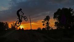 Aiming High (adam0991) Tags: sunset orange sun west silhouette swansea wales cycling dirt riding mtb mountainbiking jumps clyne mbuk