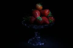 Strawberries on a glass display (Rachel Fox 1) Tags: fruit strawberries chiaroscuro