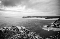 North Atlantic (Karen_Chappell) Tags: canada nfld newfoundland stjohns fortamherst capespear ocean atlantic atlanticcanada avalonpeninsula seascape landscape scenery scenic bw blackandwhite ice seaice packice spring clouds sky weather signalhill hills coast coastline snow cold eastcoast