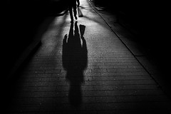 Kauppakassi (JuNu_photography) Tags: bw blackandwhite man shadow street photography photooftheday bag