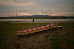 Walker and cyclist. (Yasuyuki Oomagari) Tags: river pink evening sunset slide bicycle walker rural nikon zeiss carlzeiss distagont2821 clouds riverside student