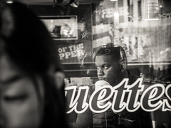 uettes (grizzleur) Tags: olympusomdem10mkii olympusm45mmf18 street streetphotography streetportrait candidphotography candid candidportrait candidstreetphotography throughthewindow reflections type typography black guy dude man drink sip sipping bw mono monochrome selfie reflection cap ny hat