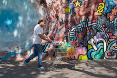 The Streets, Barcelona (Geraint Rowland Photography) Tags: thestreets art streetart spain streetartinbarcelona barcelona catalonia catalan streetphotography colours colourful sunny sunshine canon 50mm geraintrowlandphotography colourfulstreetphotography shopping shoppingtrolley candid