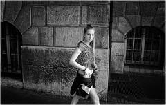 Sometimes When We're Walking Down The Sidewalk (Steve Lundqvist) Tags: streetphotography sidewalk monochrome girl beauty womenswear sweatshirt nikon nikkor 24mm sunset light strada road deutschland germany germania blonde hair teen teenager urban urbanscape location city centre town wall candid eyes contact eye walk walking pedestrian stroll
