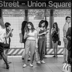 Cellphone City Subway (FourteenSixty) Tags: newyork nyc monochrome blackwhitephotos blackandwhite blackwhite subway cellphone mobilephone unionsquare unionsquarestation
