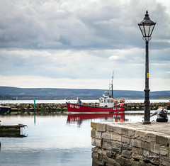 Coming Home from the Sea (clive_metcalfe) Tags: poole quay dorset uk boat fishing harbour water lamp lamppost