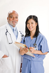 Medical Studio (tigercop2k3) Tags: portrait woman chart man male smiling female pen togetherness holding african unity happiness file medical whitebackground doctor inside nurse studioshot labcoat colleague twopeople stethoscope teamwork midadult senioradult seniorman midadultwoman lookingatcamera imagesource eastasianethnicity
