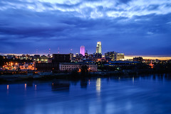 omaha skyline - clouds rushing by (laughlinc) Tags: city cityscape firstnationalbanktower heartlandofamericapark laughlinc lightroom lightroom5 longexposure missouririver nebraska night nikon1755mm24 nikond80 omaha reflection skyline water woodmentower thechallengefactory nikon