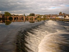 Devorgilla Bridge that crosses the River Nith near the caul (weir) in Dumfries (because of the slow shutter speed the bus on the opposite bank is a bit blurred) (penlea1954) Tags: old uk bridge lady speed standing john river scotland king slow bridges shutter oldest balliol weir dumfries galloway nith caul devorgilla devorgillas |galloway