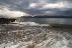 Break on through (leecaine) Tags: light sea cloud mountain storm mountains beach water weather wales waves ray north wave stormy le rays snowdonia beaumaris anglesey