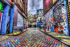 The multicoloured street (McQuaide Photography) Tags: street streetart holland netherlands amsterdam canon eos graffiti europe nederland multicoloured wideangle urbanart handheld dslr hdr lightroom uwa wideanglelens steeg ottograph ultrawideangle wijdesteeg tonemapped photomatixpro 100d 1018mm he