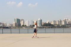 Bright Day on Han River (lilasyuri) Tags: park city red sky cloud art girl river asian town scenery asia day cityscape skateboarding bright south sunny scene korea korean seoul skateboard moment han asiatique core coren soul